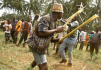 Combatants fight with banana leaf steams during the Makunduchi fighting festival in Zanzibar, Tanzania, Africa. July 1997