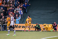 Mark O'Brien of Newport County (obscured) is mobbed after scoring his side's winning goal Newport players during the Sky Bet League 2 match between Newport County and Notts County at Rodney Parade, Newport, Wales on 6 May 2017. Photo by Mark  Hawkins / PRiME Media Images.