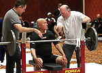 Charlie Rice, 84, talks with his trainer Scott Dolan, right, during the World Bench Press and Dead Lift Championships in Reno, Nev. on Tuesday, Nov. 2, 2011. Rice went on to set a new world record by lifting 259-1/4 pounds in the men's masters 75+ category of the bench press competition..Photo by Cathleen Allison