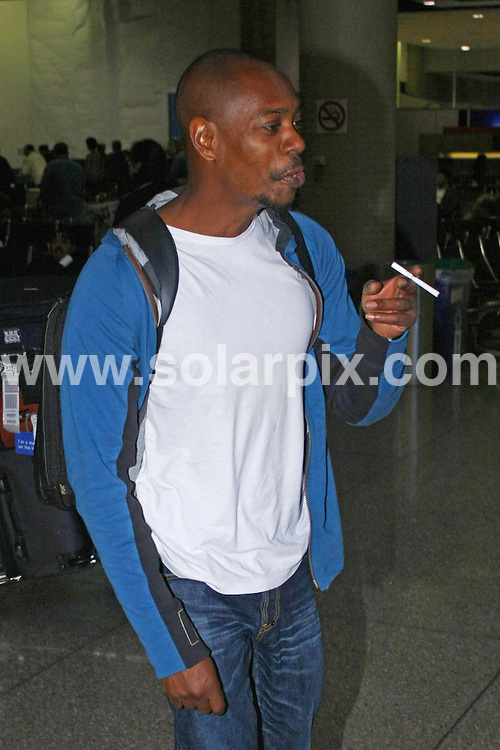 **ALL ROUND PICTURES FROM SOLARPIX.COM**.**WORLDWIDE SYNDICATION RIGHTS**.**NO PUBLICATION IN AUSTRALIA, NEW ZEALAND, DENMARK, GERMANY OR USA**.comedian Dave Chappelle enjoys a cigarette outside Los Angeles LAX Airport after a long flight home from Hong Kong. Los Angeles, California, USA. 3rd December 2008..This pic: Brooke Burke..JOB REF: 8081 LAP (JD)      DATE: 03_12_2008.**MUST CREDIT SOLARPIX.COM OR DOUBLE FEE WILL BE CHARGED* *UNDER NO CIRCUMSTANCES IS THIS IMAGE TO BE REPRODUCED FOR ANY ONLINE EDITION WITHOUT PRIOR PERMISSION*