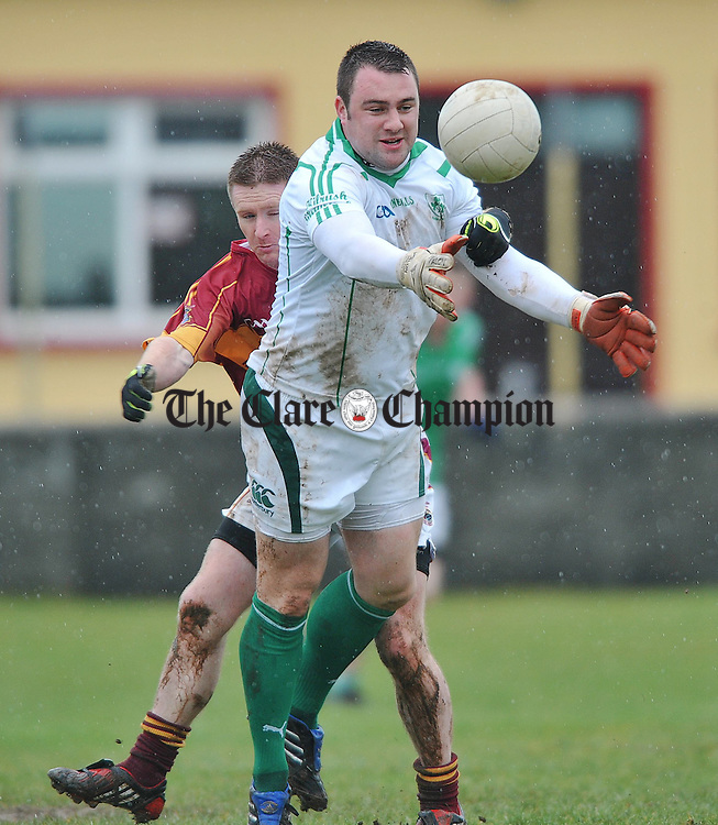 Tony Burke of Kilrush Shamrocks in action againstt Eoin Curtin of St Joseph's Miltown during their Cusack Cup game in  Miltown Malbay. Photograph by John Kelly.