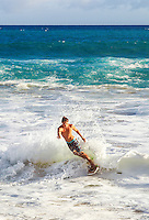 A local skimboarder at Big Beach at Makena State Park, Maui.