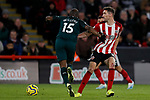 Chris Basham of Sheffield United and Jetro Willems of Newcastle United battle for the ball during the Premier League match at Bramall Lane, Sheffield. Picture date: 5th December 2019. Picture credit should read: James Wilson/Sportimage