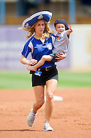 A member of the West Michigan Whitecaps game day staff carries a young fan around the bases between innings of the Midwest League game against the Quad Cities River Bandits at Fifth Third Ballpark on May 5, 2013 in Comstock Park, Michigan.  The River Bandits defeated the Whitecaps 5-4.  (Brian Westerholt/Four Seam Images)