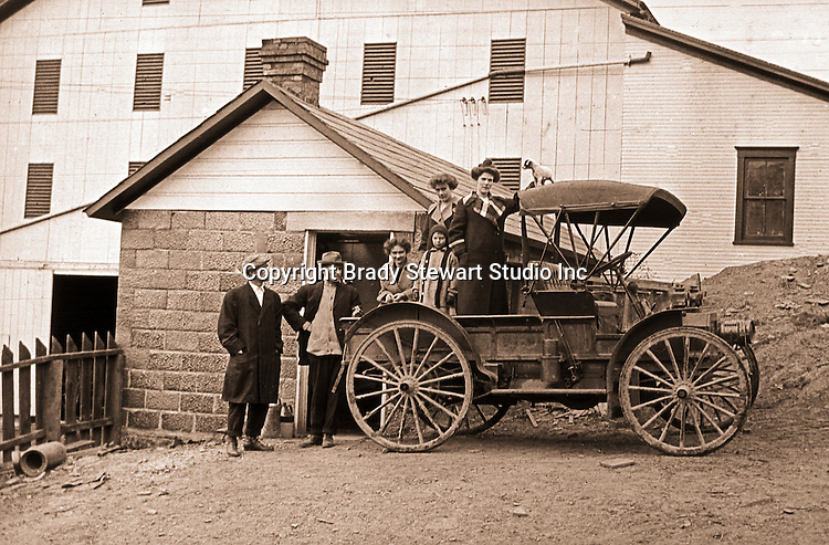 Southwestern Ohio:  Brady and Sarah Mathews Stewart and members of the Brady family posing next to the International Harvester Auto Wagon - 1916