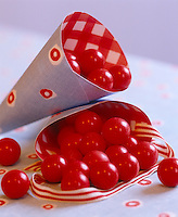 Paper cones have been filled with bright red sweets as a delicious treat for Christmas
