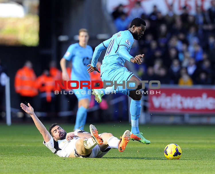 Swansea City's Jordi Amat tackles Tottenham Hotspur's Emmanuel Adebayor -   19/01/2014 - SPORT - FOOTBALL - Liberty Stadium - Swansea - Swansea City v Tottenham Hotspur - Barclays Premier League<br /> Foto nph / Meredith<br /> <br /> ***** OUT OF UK *****