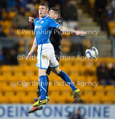 St Johnstone v Motherwell....25.02.14    SPFL<br /> James Dunne Iain Vigurs<br /> Picture by Graeme Hart.<br /> Copyright Perthshire Picture Agency<br /> Tel: 01738 623350  Mobile: 07990 594431
