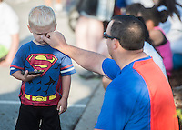 NWA Democrat-Gazette/ANTHONY REYES &bull; @NWATONYR<br /> Jared Dalmut wipes dirt from the face of his son Mason Dalmut, 3, both of Rogers, Monday, Sept. 7, 2015 at the 12th Annual Run for a Child's Hunger race at the Promenade in Rogers. The pair ran in the one mile fun run. The race has teamed up with Care Community Center to help fight hunger in the region. The event featured multiple activities including a 10K race, 5K race, fun run, inflatable playground for children and a free breakfast.