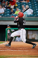 Chattanooga Lookouts right fielder Edgar Corcino (21) follows through on a swing during a game against the Jackson Generals on May 9, 2018 at AT&T Field in Chattanooga, Tennessee.  Chattanooga defeated Jackson 4-2.  (Mike Janes/Four Seam Images)
