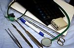 Tiel, ziekenhuis Rivierenland, gereedschap van een specialist in ziekenhuis: messen, pencelen, pen, pieper, rekenmachine, stethoscoop, papieren.© Ton Borsboom.steekwoorden: editorial gezondheidszorg, healthcare, ziekenhuis, ziekenhuizen, hospitaal, kliniek, clinic, hospital, patiënt, zorg, medische apparatuur, medische sector, geneeskunde, detail, operatiekamer, operatie kamer, OK volwassenen, wachtlijst, techniek, werkdruk, hart, bloeddruk, ziektekosten, ziektekostenverzekering, zorgpolis, zorgverzekering, nood, hygiëne, detail, abstract, besmetting, controle, fout, vergissing, arbeid, verpleging, verpleegster, verpleegkundige, arbeid, arts, specialist, dokter, doktor, docter