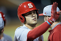 Luca Tresh (24) of the North Carolina State Wolfpack is greeted by his teammate after hitting a home run against the Wake Forest Demon Deacons at David F. Couch Ballpark on April 18, 2019 in  Winston-Salem, North Carolina. The Demon Deacons defeated the Wolfpack 7-3. (Brian Westerholt/Four Seam Images)