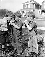 "- ""Twin boys and friend eating ice cream cone, Edmonton""<br /> <br /> Photograph by Vernon Barford. From the Barford family fonds, A11484, ca. 1913."