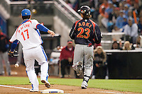 19 March 2009: #17 Seung Hwan Oh of Korea fails to catch the ball as #23 Norichika Aoki reaches first base during the 2009 World Baseball Classic Pool 1 game 6 at Petco Park in San Diego, California, USA. Japan wins 6-2 over Korea.