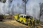 August 21, 2001 Coulterville, California  -- Creek Fire – Crews and fire trucks wait for orders on Cuneo Road.  The Creek Fire burned 11,500 acres between Highway 49 and Priest-Coulterville Road a few miles north of Coulterville, California.