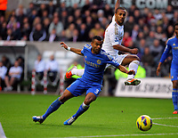 Saturday, 03 November 2012<br /> Pictured: Wayne Routledge of Swansea (TOP) crosses the ball while being marked by Ashley Cole of Chelsea (L)<br /> Re: Barclays Premier League, Swansea City FC v Chelsea at the Liberty Stadium, south Wales.