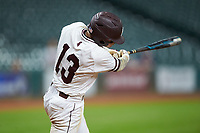 Hunter Stovall (13) of the Mississippi State Bulldogs follows through on his walk-off sacrifice fly in the bottom of the 12th inning against the Houston Cougars in game six of the 2018 Shriners Hospitals for Children College Classic at Minute Maid Park on March 3, 2018 in Houston, Texas. The Bulldogs defeated the Cougars 3-2 in 12 innings. (Brian Westerholt/Four Seam Images)