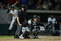 Kannapolis Intimidators catcher Michael Hickman (16) sets a target as home plate umpire Josh Gilreath looks on during the game against the Augusta GreenJackets at SRG Park on July 6, 2019 in North Augusta, South Carolina. The Intimidators defeated the GreenJackets 9-5. (Brian Westerholt/Four Seam Images)