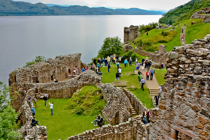 Looking across Urquhart Castle at the tourists on Loch Ness.