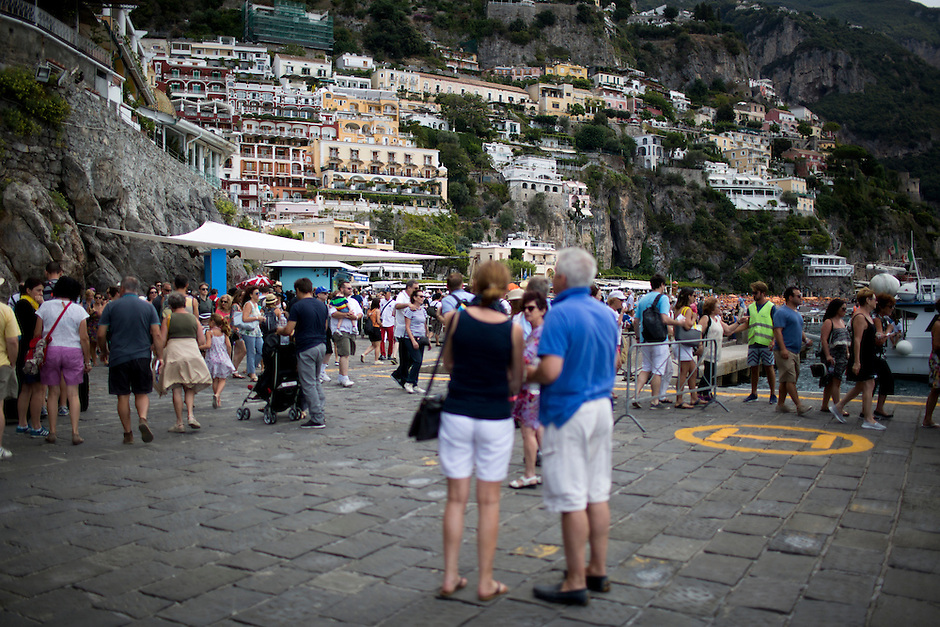 Tourists disembark from a ferry on Sunday, Sept. 20, 2015, in Positano, Italy. (Photo by James Brosher)