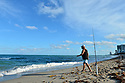 HALLANDALE BEACH, FL - MARCH 17: People walking and fishing on a almost empty beach. Barricades and Signage indicates that an area of Hallandale Beach is closed on March 17, 2020 in Hallandale Beach, Florida. Republican Florida Gov. Ron DeSantis and Hallandale Beach City officials closed the area of the beach that is popular with college spring breakers and asked them to refrain from large gatherings where COVID-19 could spread on March 17, 2020 in Hallandale Beach, Florida.  ( Photo by Johnny Louis / jlnphotography.com )