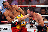 Daniel Geale (Aust) and Anthony Mundine (Aust) battle it out at the I.B.F. Middleweight Title fight Mundene V Geale 2 at The Sydney Entertainment Centre on January 30, 2013 in Sydney, Australia. (Photo by Paul Barkley/LookPro)