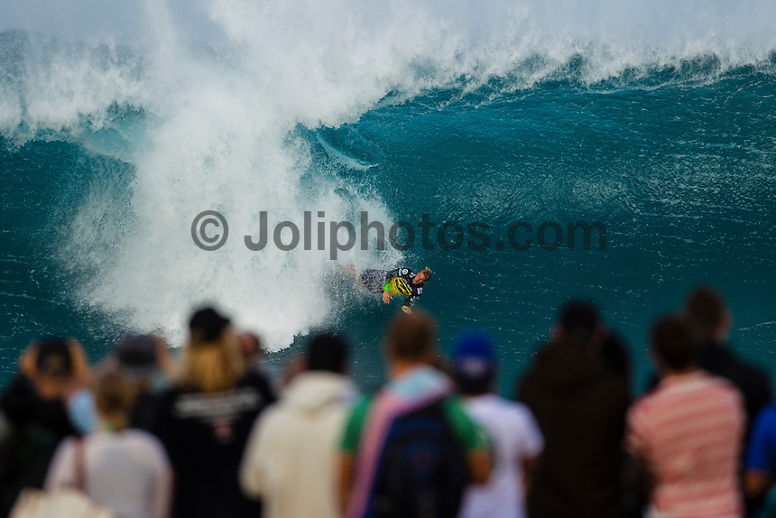 HONOLULU - (Friday, December 14, 2012) Josh Kerr (AUS). -- The BILLABONG PIPE MASTERS In Memory of Andy Irons  concluded today in spectacular way. The 2012 ASP World Title was decided between Joel Parkinson (AUS) and Kelly Slater (USA) with Parkinson finally holding the World Title trophy above his head in front of thousands of surf fans..Slater was defeated by Josh Kerr (AUS) in the semi finals finishing his chance of winning a 12th World Title. Waves were  in the 6 to 8-feet for most of the day..Sebastien Zietz (HAW) won the 2012 Vans Triple Crown of Surfing title winning $100,000, a Harley Davidson motorcycle and a $10,000 Nixon watch..Photo: joliphotos.com