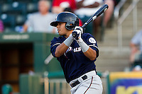 Mario Lisson (29) of the Northwest Arkansas Naturals follows through his swing during a game against the Springfield Cardinals at Hammons Field on August 1, 2011 in Springfield, Missouri. Springfield defeated Northwest Arkansas 7-1. (David Welker / Four Seam Images)