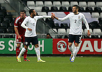 Pictured L-R: Nathan Redmond of England celebrating his second goal with team mate Carl Jenkinson. Monday 19 May 2014<br />