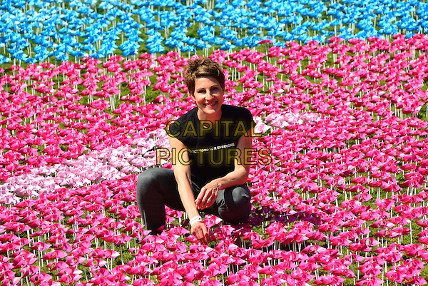 Tamsin Greig<br /> Big IF London event as part of campaign to tackle world hunger, on the same day as the international Hunger Summit hosted by David Cameron, Hyde Park, London, United Kingdom, June 8th 2013.<br /> half length pink windmills flowers blue holding black t-shirt Enough Food for Everyone kneeling <br /> CAP/BF<br /> &copy;Bob Fidgeon/Capital Pictures