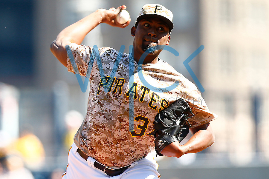 Arquimedes Caminero #37 of the Pittsburgh Pirates pitches against the Detroit Tigers during the game at PNC Park in Pittsburgh, Pennsylvania on April 14, 2016. (Photo by Jared Wickerham / DKPS)