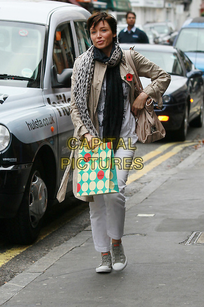 Dannii Minogue out and about in London, England..November 6th, 2011.full length beige mac coat jacket black scarf print jeans denim green bag purse yellow polka dot poppy.CAP/HIL.©John Hillcoat/Capital Pictures .