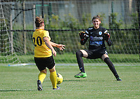 20160827 - ZWEVEZELE , BELGIUM : Zwevezele's Celine Vandekerckhove on her way to the opening goal with Genk's goalkeeper Celien Baeten pictured during the soccer match  in the 2nd round of the  Belgian cup 2017 , a soccer women game between SK Voorwaarts Zwevezele and RC Genk Ladies  , in Zwevezele , saturday 27 th August 2016 . PHOTO SPORTPIX.BE / DIRK VUYLSTEKE