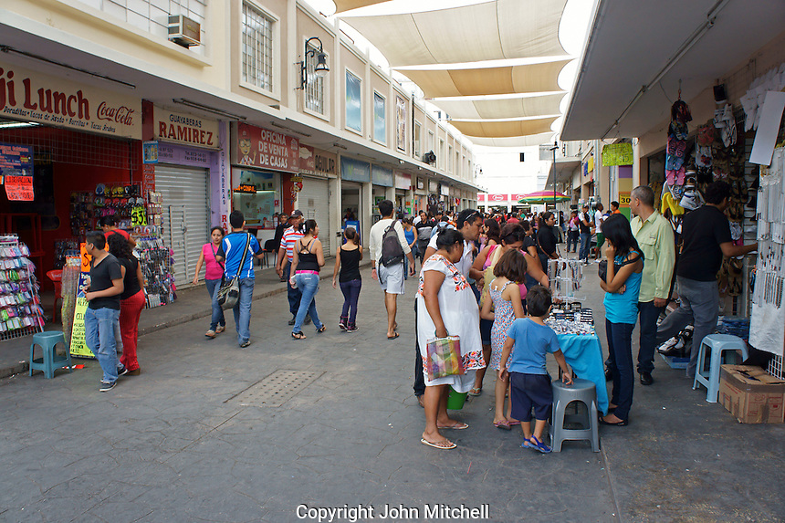 People in a crowded shopping mall in downtown Merida, Yucatan, Mexico..