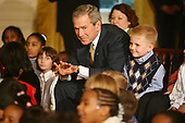 United States President George W.  Bush and first lady Laura Bush attend a ceremony celebrating the holidays with various school children from different schools in the East Room of the White House in Washington, DC on December 5, 2005. Many of the children's parents are serving in the military and are away from home during this holiday season.  The ABT (American Ballet Theatre) performed the Nutcracker Ballet for the children and the President.<br /> Credit:  Gary Fabiano/Pool via CNP