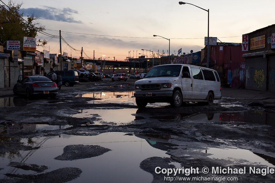 QUEENS, NY -- OCTOBER 22, 2013:  A van maneuvers the potholes on Willets Point Blvd in Willets Point on October 22, 2013 in Queens.  Photographer: Michael Nagle for The New York Times