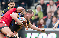 Picture by Allan McKenzie/SWpix.com - 07/04/2018 - Rugby League - Betfred Super League - Salford Red Devils v Warrington Wolves - AJ Bell Stadium, Salford, England - Warrington's Ben Currie is tackled by Salford.
