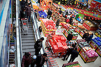 Shoppers browse Lunar New Year sales in a supermarket in Pingliang, Gansu, China.