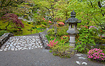 Seattle, WA: Gently arching stone bridge in the Japanese Garden in Washington Park Arboretum in spring