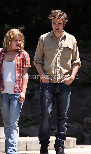 WWW.ACEPIXS.COM . . . . .  ....June 30 2009, New York City....Actors Robert Pattinson and Emilie De Ravin on the Central Park set of the new movie 'Remember Me' on June 30 2009 in New York City....Please byline: AJ Sokalner - ACEPIXS.COM..... *** ***..Ace Pictures, Inc:  ..tel: (212) 243 8787..e-mail: info@acepixs.com..web: http://www.acepixs.com