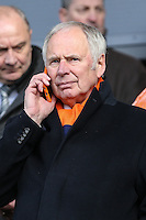 Luton Town Chairman, Nick Owen, on the phone ahead of the Sky Bet League 2 match between Barnet and Luton Town at The Hive, London, England on 28 March 2016. Photo by David Horn.