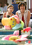 BEACON FALLS, CT - 09 JUNE 2005 -060905JS02--Christine Monti of Beacon Falls, right, reacts to the attempt of her daughter Olivia Monti, 9, as she tries her hand at the Mr. Frog skill game on the opening night of the annual Beacon Falls Hose Co. #1 carnival in Beacon Falls on Thursday. The carnival, which benefits the Beacon Falls Hose Co. 1, will run through Saturday finishing with a parade at 6 p.m.  --Jim Shannon Photo-- are CQ