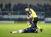 3rd December 2019; Pirelli Stadium, Burton Upon Trent, Staffordshire, England; English League One Football, Burton Albion versus Southend United; Elvis Bwomono of Southend United slides in to get his foot in front of Scott Fraser of Burton Albion to take the ball - Strictly Editorial Use Only. No use with unauthorized audio, video, data, fixture lists, club/league logos or 'live' services. Online in-match use limited to 120 images, no video emulation. No use in betting, games or single club/league/player publications