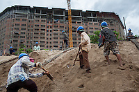 May 27, 2012 - Phnom Penh, Cambodia. Workers build a re-enforced bank on the edge of the Tonle Sap and Mekong River. © Nicolas Axelrod / Ruom