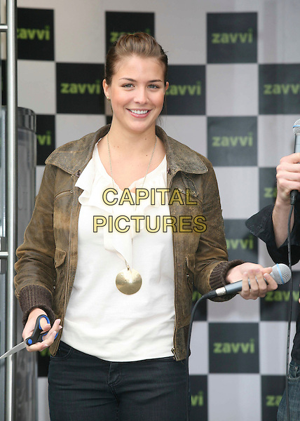 GEMMA ATKINSON.Opens the new Zavvi store in Camberley, Surrey, England, .14th March 2008..half length gold disc necklace brown jacket cream ruffle top .CAP/DS.©Dudley Smith/Capital Pictures
