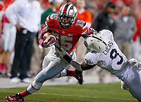 Ohio State Buckeyes running back Ezekiel Elliott (15) stiff arms Penn State Nittany Lions cornerback Jordan Lucas (9) on a rush upfield during the second half of the NCAA football game at Ohio Stadium in Columbus on Oct. 26, 2013. (Adam Cairns / The Columbus Dispatch)