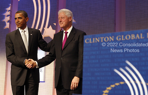 New York, NY - September 22, 2009 -- United States President Barack Obama (L) and former President Bill Clinton shakes hands after Obama spoke at the Clinton Global Initiative at the Sheraton Hotel in New York City on Tuesday, September 22, 2009.    .Credit: John Angelillo / Pool via CNP