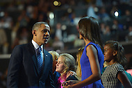 September 6, 2012  (Charlotte, North Carolina) President Barack Obama speaks to daughter Sasha at the end of the 2012 Democratic National Convention in Charlotte.   (Photo by Don Baxter/Media Images International)