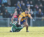 Ian Galvin of  Clare  in action against Colin Ryan of  Limerick during their NHL quarter final at the Gaelic Grounds. Photograph by John Kelly.