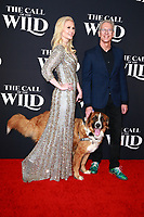 HOLLYWOOD, CA - FEBRUARY 13; Chris Sanders, Buck the dog and Guest at The Call Of The Wild World Premiere on February 13, 2020 at El Capitan Theater in Hollywood, California. Credit: Tony Forte/MediaPunch